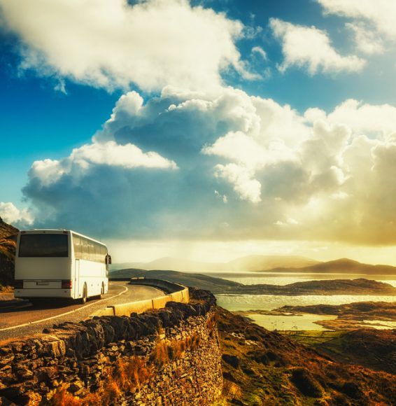 Tourist,White,Bus,On,Mountain,Road.,Ring,Of,Kerry,,Ireland.